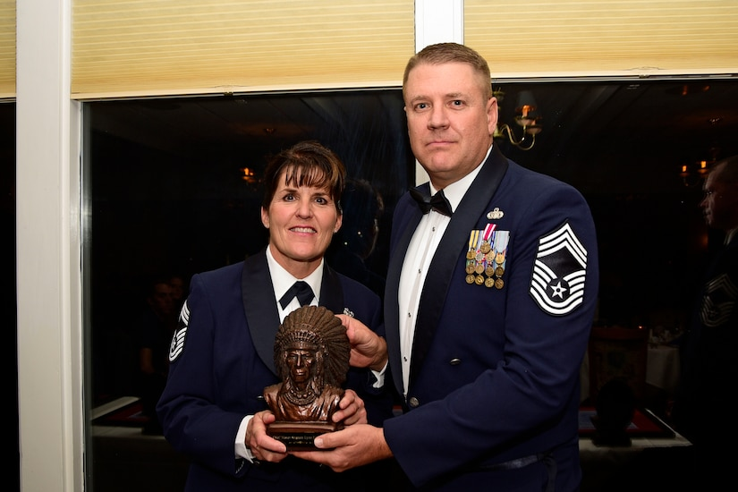 Chief Master Sgt. Dale Gunter presents a sculpture to Chief Master Sgt. Lynn U. Oatman during the Montana Air National Guard Chief Induction Ceremony held at the Meadowlark Country Club in Great Falls, Mont., Oct. 14, 2017. Chief Master Sgts. Chad W. Anderson, Joel R. Clum, Lynn U. Oatman and Sean P. O'Connell were inducted during the ceremony into the top United States Air Force enlisted rank. (U.S. Air National Guard photo/Senior Master Sgt. Eric Peterson)