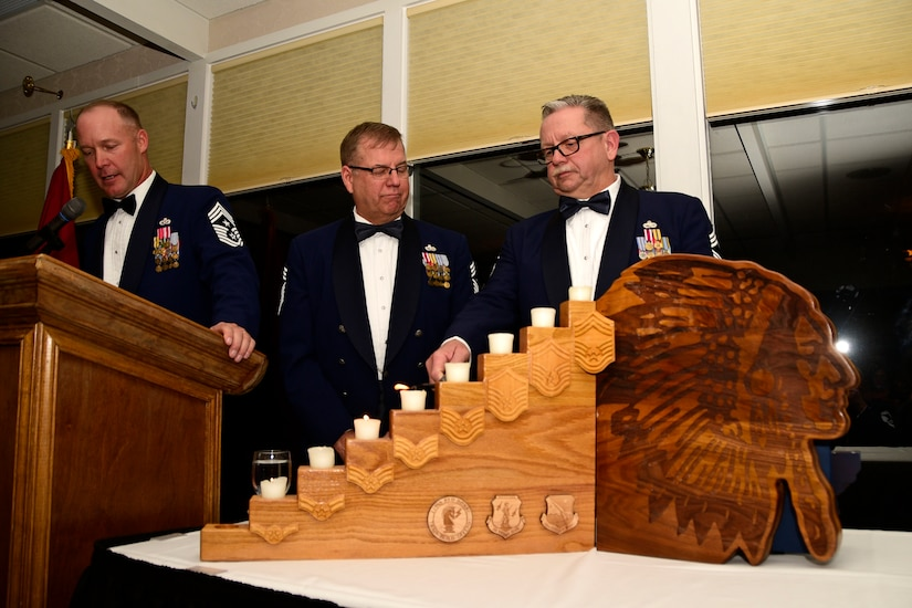 Chief Master Sgt. Joel Clum lights a candle representing the United States senior Airman rank during the Montana Air National Guard Chief Induction Ceremony held at the Meadowlark Country Club in Great Falls, Mont., Oct. 14, 2017. Chief Master Sgts. Chad W. Anderson, Joel R. Clum, Lynn U. Oatman and Sean P. O'Connell were inducted during the ceremony into the top United States Air Force enlisted rank. (U.S. Air National Guard photo/Senior Master Sgt. Eric Peterson)