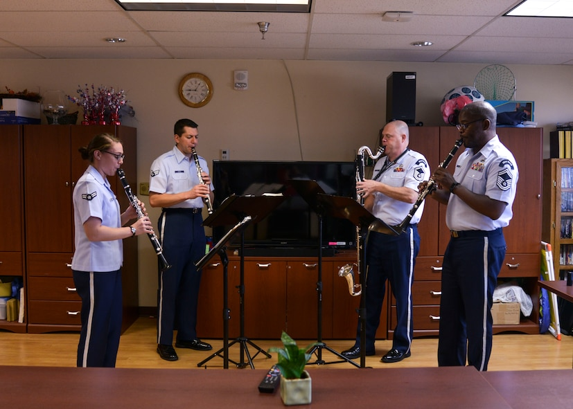 The Air Force Academy's Clarinet Quartet play a medley of iconic military songs at the Raymond G. Murphy Veterans Affairs Medical Center, N.M., Oct. 21, 2017.  The quartet visited to play a few songs for the veterans as well as participate in fellowship. (U.S. Air Force photo by Airman 1st Class Lexi Crawford)