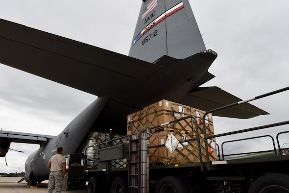 A 317th Airlift Wing crew works with air transporters from the 612th Air Base Squadron to off load pallets during a routine global channel mission Oct. 18, 2017, to Soto Cano Air Base, Honduras. The C-130J crew delivered sustainment and supplies to Airmen supporting Joint Task Force-Bravo.  Airmen from Soto Cano Air Base rely on the mission to bring items needed to complete their mission while stationed in the Central American country.  (Air Force photo by Master Sgt. Kristine Dreyer)