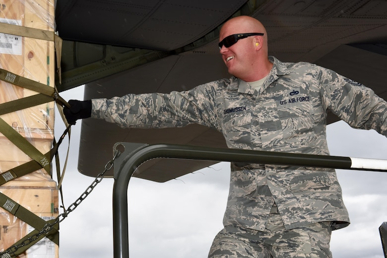 Tech. Sgt. Jonathan Resmussen, 612th Air Base Squadron, Air Transportation Operations Center section chief, pulls a pallet off the C-130J from the 317th Airlift Wing Oct. 18, 2017, at Soto Cano Air Base, Honduras.  The pallets were delivered as part of a routine channel mission delivering sustainment and equipment to Airmen stationed in the Central American country. The Airmen from the 317th Airlift Wing at Dyess Air Force, Texas, routinely support the Honduras mission, a tasking from the 618th Air Operations Center.  (Air Force photo by Master Sgt. Kristine Dreyer)