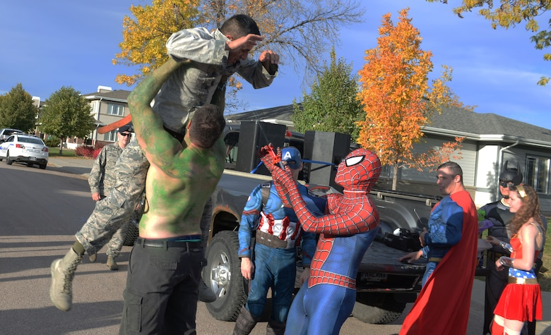 "Jon Spiecher, the resource advisor for the 28th Security Forces Squadron, dressed as a superhero, stops a ""criminal"" played by Airman 1st Class Michael Escalante, a 28th SFS member, at Ellsworth Air Force Base, S.D., Oct. 11, 2017.  The SFS hosts the annual Superhero Parade for Crime Prevention Month among others including Trunk or Treat, Little Defenders, Pumpkin Patrol, Cops and Neighbors, a weapons display and a visit to the Child Development Center by McGruff the Crime Dog. (U.S. Air Force photo by Airman 1st Class Thomas Karol)"