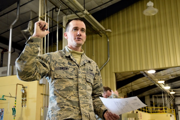 219th RED HORSE Squadron Emergency Manager Master Sgt. Coltin Sweeney instructs squadron members on packing personal equipment during deployment preparation at Malmstrom Air Force Base, Mont., Oct. 4, 2017. Sweeney was the first member of the 219th RHS to graduate from the United States Army Air Assault School at Fort Hood, Texas. (U.S. Air National Guard photo/Senior Master Sgt. Eric Peterson)