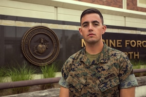 Cpl. Eric Gore, the chemical, biological, radiological and nuclear defense specialist training non-commissioned officer with Headquarters Battalion, Marine Forces Reserve, stands outside of Marine Corps Support Facility in New Orleans, Oct. 16, 2017.