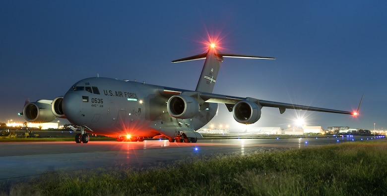 A C-17A Globemaster III from the 445th Airlift Wing, Wright-Patterson Air Force Base, Ohio, Air Force Reserve Command, prepares to take off after picking-up Patriot missiles at Tinker Air Force Base, Oklahoma, Sept. 12, 2017. The C-17A is the primary airlifter used by Air Mobility Command. (U.S. Air Force photo/Greg L. Davis)
