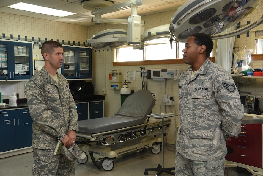 7th AF vice commander, Brig. Gen. Lansing Pilch, receives a brief from an ambulance services technician assigned to the 8th Medical Group.