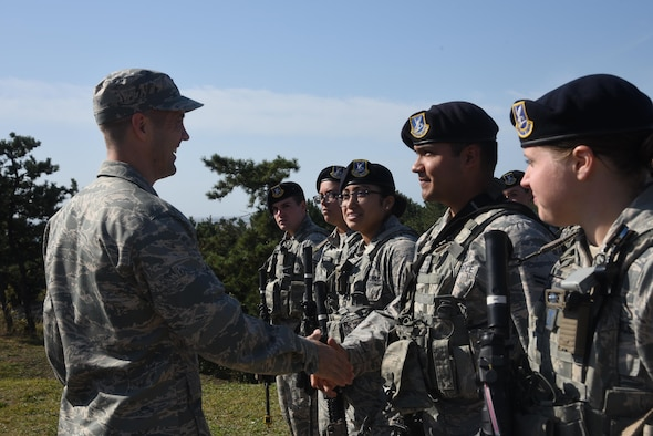 7th AF vice commander, Brig. Gen. Lansing Pilch, greets Defenders assigned to the 8th Security Forces Squadron.