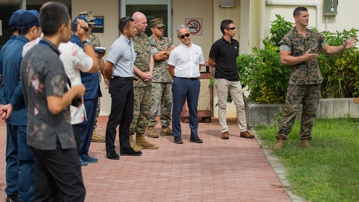 Sgt. David McCarty explains the different training during a K-9 demonstration for the Okinawa Prefectural Police.