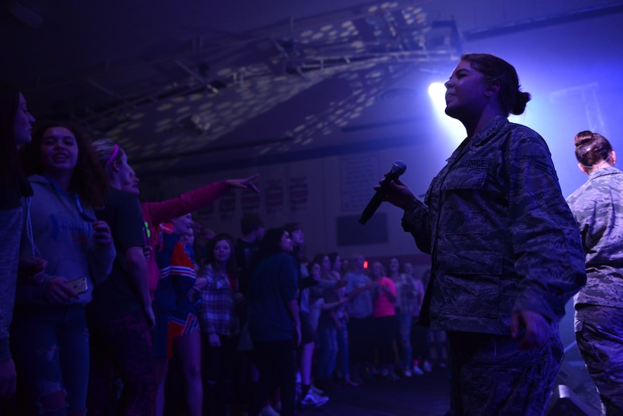 Airman 1st Class Aliyah Richling, right, a vocalist with the Heartland of America Band's Raptor ensemble, right, pauses while singing with high schoolers at Sioux Center High School in Sioux Center, Iowa, Oct. 13, 2017. The ensemble partnered with local recruiters to reach high school students with the Air Force mission on the tour.