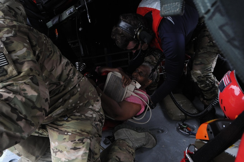 People aided by Airmen from the New York Air National Guard's 106th Rescue Wing conducting rescue operations in the Beaumont, Texas area on August 30, 2017 rest on board an HH-60 Pavehawk helicopter. The 106th Rescue Wing deployed 120 Airmen, three HH-60 Pavehawk rescue helicopters and two HC-130 search and rescue aircraft to aid the Texas National Guard. (U.S. Air National Guard photo by Airman 1st Class Daniel H. Farrell)