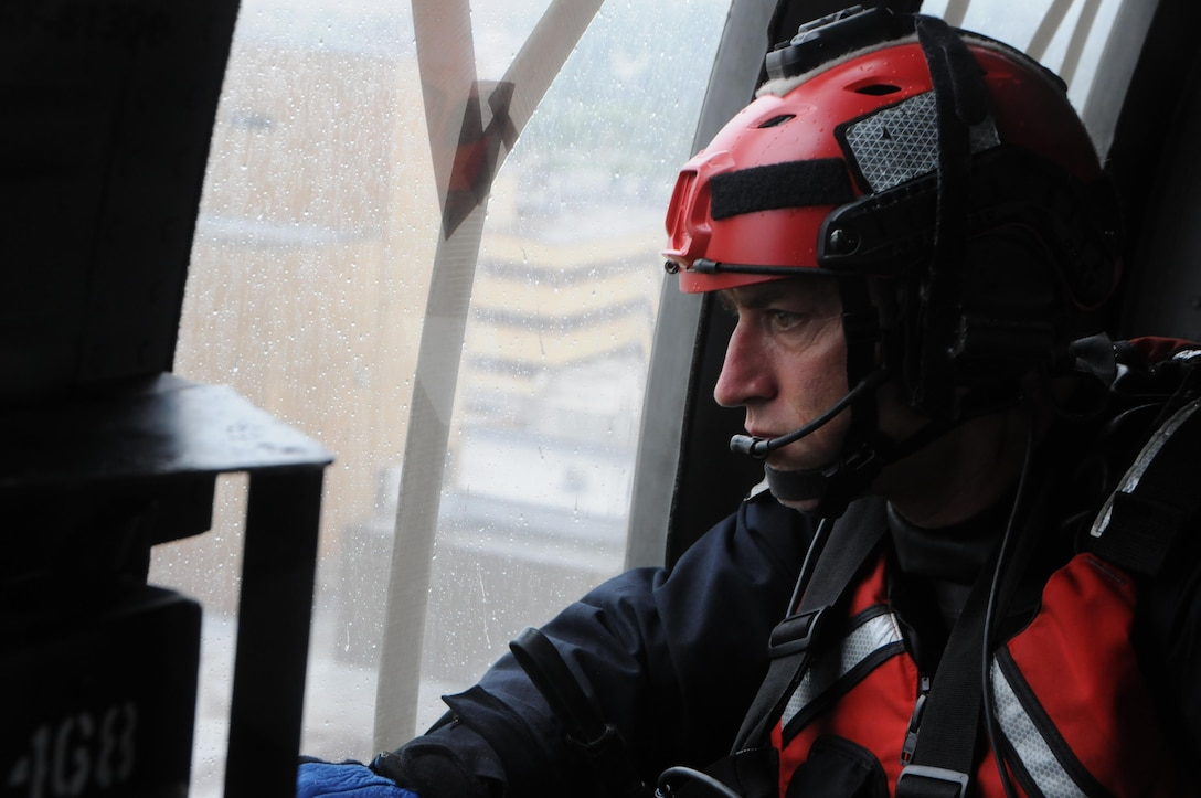 Maj. Glynn Weir, a combat rescue officer, assigned to the New York Air National Guard's 106th Rescue wing surveys the flood waters engulfing Houston, Texas during rescue operations on August, 30, 2017. The New York Air National Guard dispatched 120 Airmen, 3 HH-60 Pavehawk rescue helicopters and two HC-130 search and rescue aircraft to aid the Texas National Guard. (U.S. Air National Guard photo by A1C Daniel Farrell)