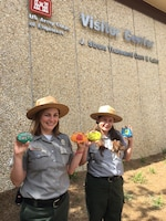 Park Rangers Heather Killips and Sheila Larson share rocks painted by volunteers as part of Thurmond Lake's National Public Lands Day event, Sept. 30.  The rocks are being placed around Thurmond's public areas for visitors to find and share on social media.