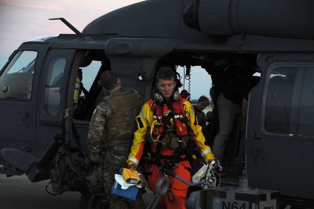 U.S. Air Force Senior Airman James M. Zambik, a pararescueman with the 103rd Rescue Squadron of the 106th Rescue Wing assigned to the New York Air National Guard, exits the HH-60 Pavehawk helicopter at Fort Hood, Texas, August 28, 2017. The efforts of Zambik and the Airmen of 106th helped save 255 people and two dogs during today's mission. (U.S. Air National Guard photo by Airman 1st Class Daniel H. Farrell