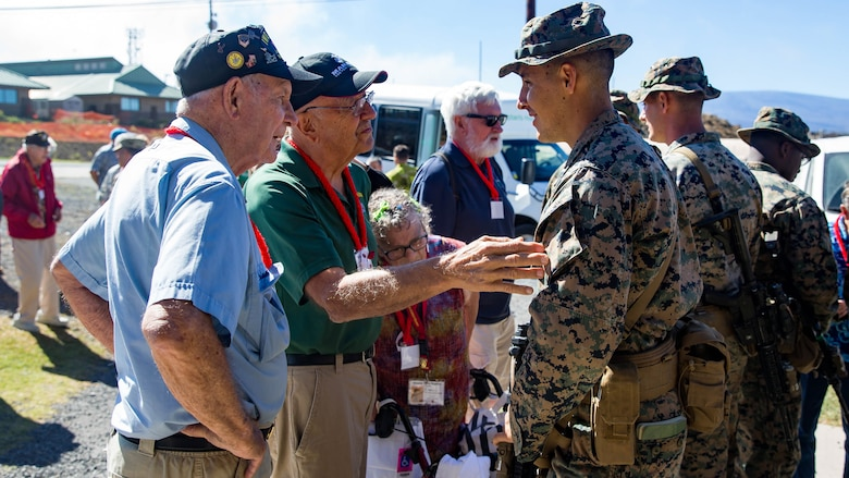 U.S. Marine veterans from the 5th Marine Division talk with U.S. Marine Sgt. Tyler Zeller, a member of 2nd Battalion, 3rd Marines.
