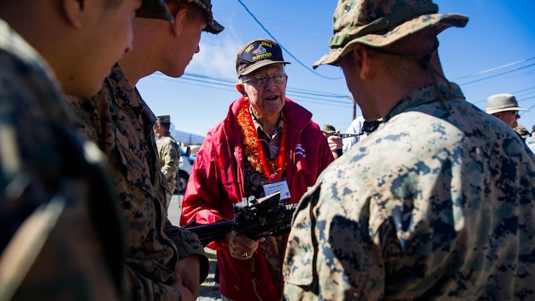 U.S. Marine veteran of the 5th Marine Division Louie Lepore talks with U.S. Marines with 2nd Battalion, 3rd Marines during a visit to Pohakuloa Training Area on the Island of Hawaii.