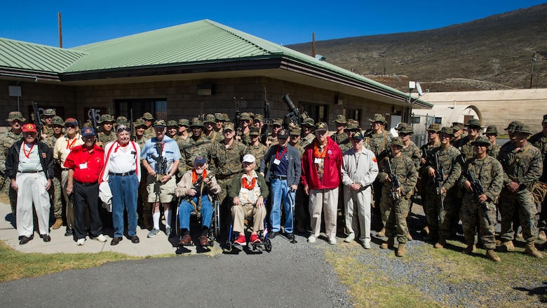 U.S. Marine veterans with the 5th Marine Division pose for a photo with U.S. Marines with 2nd Battalion, 3rd Marine Regiment.