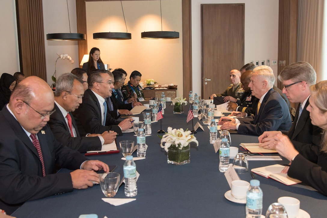 Defense Secretary Jim Mattis meets with the Malaysian defense minister.