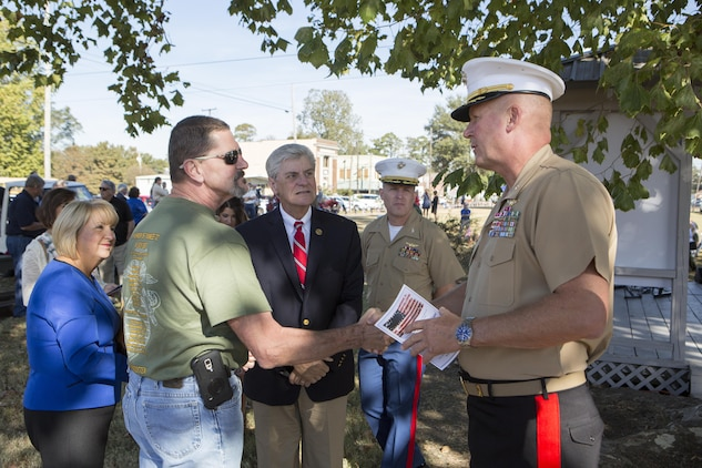 Brig. Gen. Bradley James (right), commanding general of 4th Marine Aircraft Wing, Marine Forces Reserve, shakes the hand of a Gold Star family member (center left) in Moorhead, Miss., Oct. 19, 2017. James, Gov. Phil Bryant (center), the governor of Mississippi, and his wife Deborah Bryant (left), attended a memorial that remembered the lives of the 15 Marines and one sailor who perished in a C-130 plane crash in July 2017. (U.S. Marine Corps photo by Cpl. Dallas Johnson)