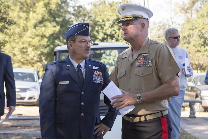 Brig. Gen. Billy Nabors (left), the Mississippi Air National Guard chief of staff, and Brig. Gen. Bradley James, commanding general of 4th Marine Aircraft Wing, Marine Forces Reserve, discuss the turnout of the memorial they are attending, in Moorhead, Miss., Oct. 19, 2017. Nabors and James attended the memorial to not only remember the 15 Marines and one sailor who perished in July 2017, but to also celebrate the 200th birthday of the state of Mississippi. (U.S. Marine Corps photo by Cpl. Dallas Johnson)