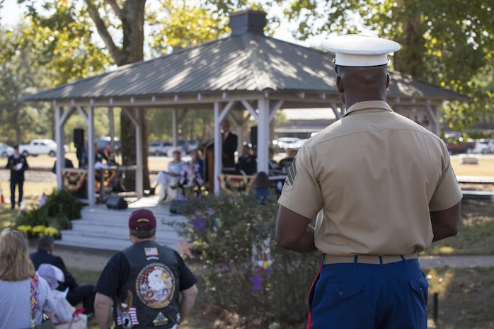 A local Marine recruiter watches Gov. Phil Bryant, the governor of Mississippi, give a speech to residents of his hometown, Moorhead, Miss., Oct. 19, 2017. Leaders with 4th Marine Aircraft Wing, Marine Forces Reserve, and a host of residents and other service members attended the event that not only celebrated the 200th birthday of Mississippi, but to also pay tribute to the 15 Marines and one sailor who perished in a C-130 crash in July 2017. (U.S. Marine Corps photo by Cpl. Dallas Johnson)