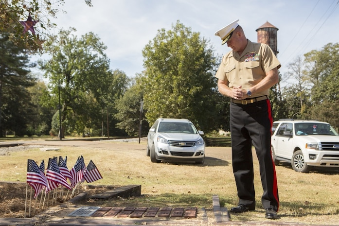 Brig. Gen. Bradley James, the commanding general of 4th Marine Aircraft Wing, Marine Forces Reserve, reads the names on bricks that were laid to memorialize the lives of the 15 Marines and one sailor who died in a C-130 plane crash in July 2017, in Moorhead, Miss., Oct. 19, 2017. James attended the memorial event that not only paid tribute to the fallen service members, but to also celebrate the 200th birthday of the state of Mississippi. (U.S. Marine Corps photo by Cpl. Dallas Johnson)