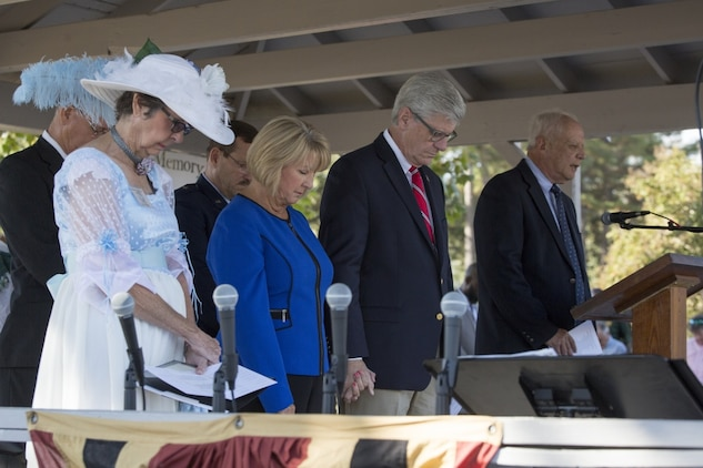 Phil Bryant (center), the governor of Mississippi, and his wife Deborah Bryant, bow their heads in prayer during the invocation, led by Ray Bridges (right), at the Mississippi Bicentennial Celebration, in Moorhead, Miss., Oct. 19, 2017. The Moorhead Garden Club held Mississippi's 200th birthday in Moorhead to not only celebrate the state's birthday, but to also honor, and pay tribute to, the 15 Marines and one sailor who perished in a C-130 plane crash on July 10, 2017, in the nearby county of Leflore. (U.S. Marine Corps photo by Cpl. Dallas Johnson)