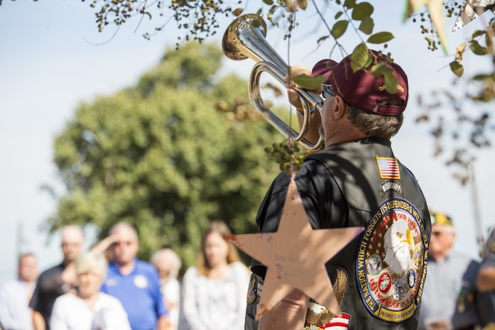 "David Weeks, a member of the Patriot Guard Riders, plays ""Taps"" after the roll-call of the 15 Marines and one sailor who died in a C-130 plane crash in Leflore county, in Moorhead, Miss., Oct. 19, 2017. Weeks, leaders from 4th Marine Aircraft Wing, Mississippi Gov. Phil Bryant and numerous other residents of Moorhead, attended the Mississippi Bicentennial Celebration to not only celebrate the state's 200th birthday, but to honor and pay their respects to the fallen service members. (U.S. Marine Corps photo by Cpl. Dallas Johnson)"