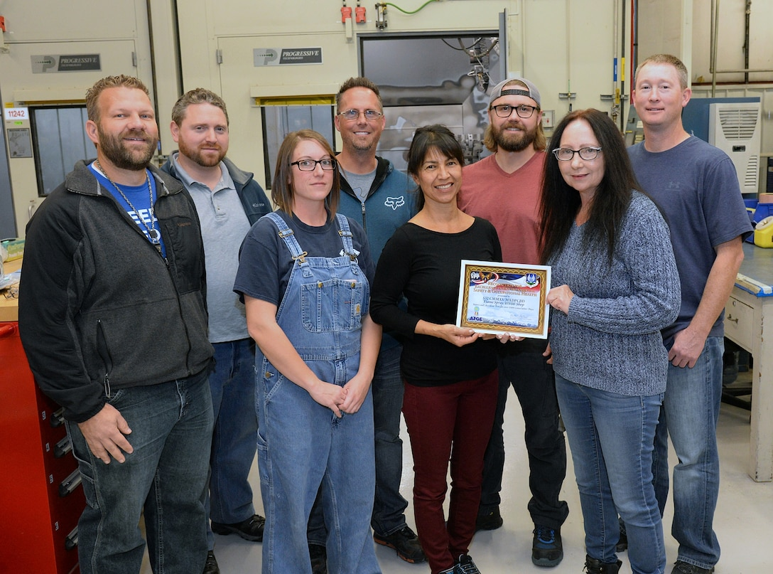 (Left to Right) Matt Farmer, Zach Walker, Francesca Roschewski, Russell Stewart, Mona Hogenson, Aaron Ames, Anita Henderson and Tally Thomas, 532nd Commodities Maintenance Squadron's flame spray/high velocity oxygen fuel shop, were recognized by Ogden Air Logistics Complex leadership Oct. 21, 2017, for accumulating more than 1,500 days of injury and accident free work days dating back to Jan. 3, 2013. (U.S. Air Force photo by Alex R. Lloyd)