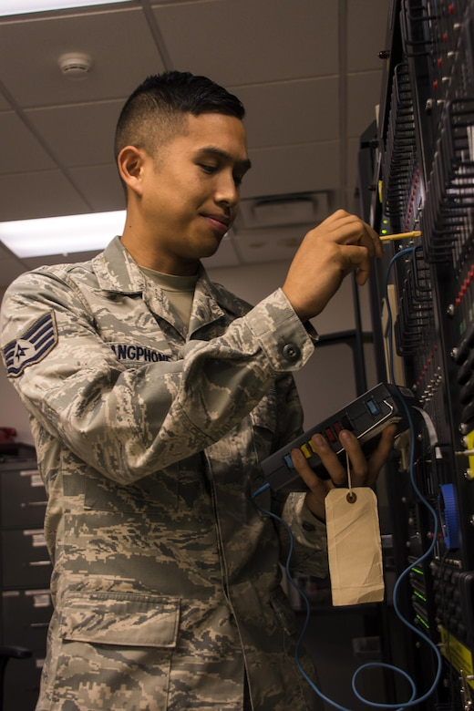 Staff Sgt. Sony K. Luangphone, 60th Operations Support Squadron air traffic control landing systems technician, optimizes line levels for radio frequencies Oct. 24 on Travis Air Force Base, Calif. The radio technology employed by the 60th OSS allowed pilots and emergency personnel to reach their destinations in the safest and most efficient manner so as to deliver aid to those devastated by the recent natural disasters.