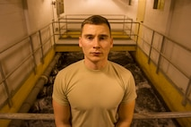 U.S. Air Force Airman 1st Class Jacob Hull, a 354th Civil Engineer Squadron waste water plant operator, poses for a photo Oct. 19, 2017, at Eielson Air Force Base, Alaska. Eielson's waste water plant is one of five in the Air Force. (U.S. Air Force photo by Airman 1st Class Eric M. Fisher)