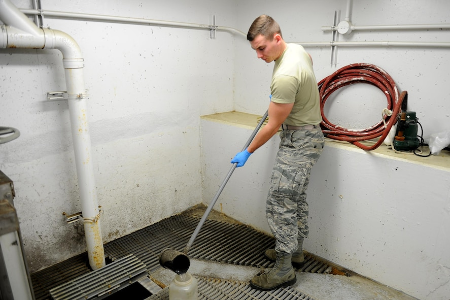 U.S. Air Force Airman 1st Class Jacob Hull, a 354th Civil Engineer Squadron waste water plant operator, gathers water for testing Oct. 19, 2017, at Eielson Air Force Base, Alaska. Waste water plant operators conduct tests three times daily to check water for its pH levels. (U.S. Air Force photo by Airman 1st Class Eric M. Fisher)