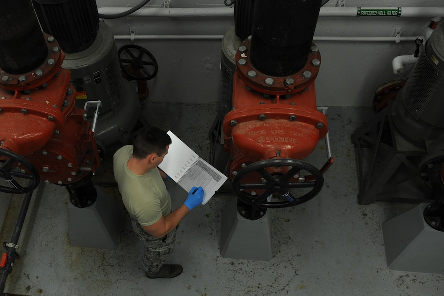 U.S. Air Force Airman 1st Class Jacob Hull, a 354th Civil Engineer Squadron waste water plant operator, records gauge readings on a clipboard Oct. 19, 2017, at Eielson Air Force Base, Alaska. Hull reads and records water pressure levels throughout the plant to ensure the equipment is working properly. (U.S. Air Force photo by Airman 1st Class Eric M. Fisher)