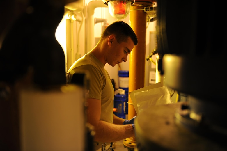 U.S. Air Force Airman 1st Class Jacob Hull, a 354th Civil Engineer Squadron waste water plant operator, records gauge readings on a clipboard Oct. 19, 2017, at Eielson Air Force Base, Alaska. Hull read and recorded temperature and pressure gauges in the plant to ensure the equipment is working properly. (U.S. Air Force photo by Airman 1st Class Eric M. Fisher)