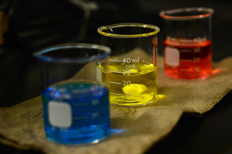 Beakers of pH buffer solution sit on a paper towel Oct. 19, 2017, at Eielson Air Force Base, Alaska. The pH buffer solution calibrates the equipment used to test water samples at the waste water plant. (U.S. Air Force photo by Airman 1st Class Eric M. Fisher)