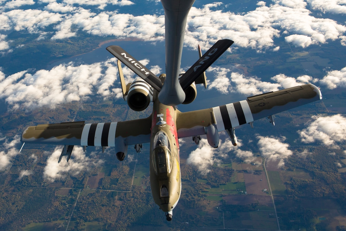 An A-10 with the 107th Fighter Squadron, flies with a KC-135 Stratotanker with the 171st Air Refueling Squadron over Northern Michigan on Oct. 11, 2017.