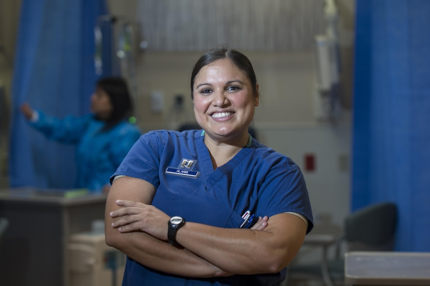 Capt. Kendra Alanis, 60th Medical Operations Squadron clinical nurse, poses for a photo in the hematology/oncology clinic Oct. 24, 2017 at Travis Air Force Base, California. Alanis provides therapeutic and consultative services to the patients she supports. (Air Force photo by Airman 1st Class Jonathon D. A. Carnell)