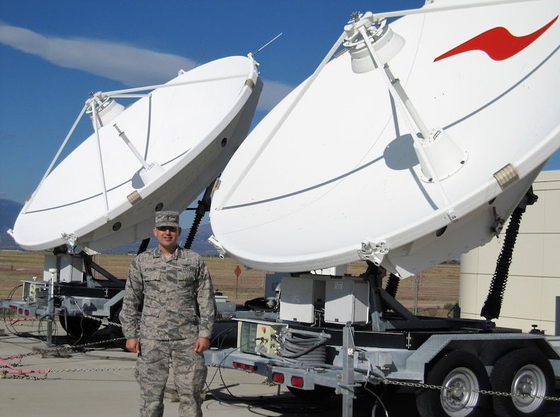 2nd Lt. Dan Vasquez, 16th Space Control Squadron crew commander, along with some of the equipment used by the 16th SPCS, Oct. 20, 2017 at Peterson Air Force Base, Colorado. The 16th SPCS defends access to the space domain by identifying, characterizing, and geolocating sources of electromagnetic interference on U.S. military and commercial satellites. (Courtesy photo)
