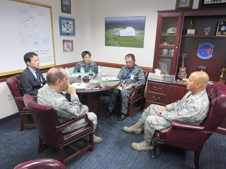 Three members of the Japanese Space Situational Awareness Policy office meet with Lt. Col. Raj Agrawal (right), 20th Space Control Squadron commander, Oct. 4, 2017, at Eglin Air Force Base, Florida. The three visitors including Lt. Col. Darrell Myers (left), Air Force branch chief for international engagement, learned about the phased array radar for the Space Mission Task Force construct, integration of intelligence and various other space surveillance capabilities. (Courtesy photo)