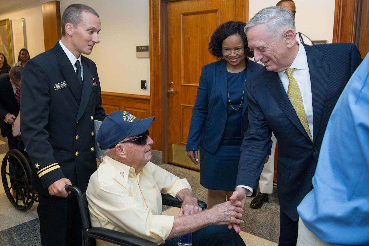 Defense Secretary Jim Mattis speaks with a survivor of the USS Arizona.