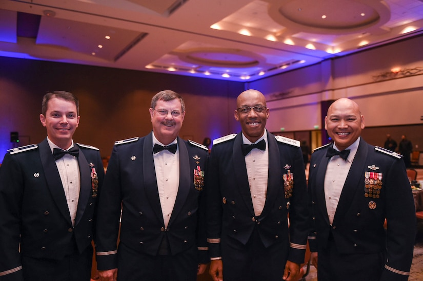 (From left to right) Col. Jeffrey Nelson, 628th Air Base Wing commander, Col. Gregory Gilmour, 315th Airlift Wing commander, Lt. Gen. Charles Brown, U.S. Central Command deputy commander and Col. Jimmy Canlas, 437th Airlift Wing commander, get together before the start of the Air Force Ball at the Charleston Area Convention Center in North Charleston, S.C., Oct. 21, 2017.