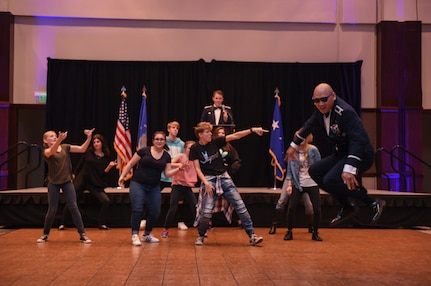 Col. Jimmy Canlas, 437th Airlift Wing commander, shows off his dance moves as an ice breaker during Col. Jeffery Nelson, 628th Air Base Wing commander's, speech at the Air Force Ball in the Charleston Area Convention Center in North Charleston, S.C., Oct. 21, 2017.