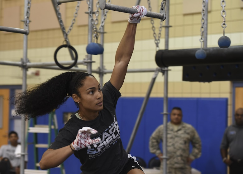 U.S. Air Force 2nd Lt. Nicole Mitchell, 83rd Network Operations Squadron directory services officer in charge, swings across the Battle Rig broken bars during the Alpha Warrior Northeast Regional Competition at Joint Base Langley-Eustis, Va., Oct. 21, 2017.
