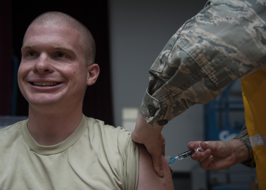 U.S. Air Force Staff Sgt. Noah Dudley, 377th Logistics Readiness Squadron vehicle operator, receives the flu vaccination at Kirtland Air Force Base, N.M., Oct. 24. It takes two weeks for protection to develop after vaccination. (U.S. Air Force photo by Staff Sgt. J.D. Strong II)