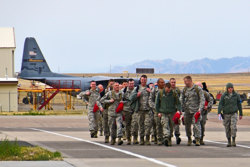 Members of the 219th RED HORSE Squadron of the Montana Air National Guard prepare to board a 120th Airlift Wing C-130 Hercules transport aircraft in Great Falls, Mont., Oct. 11, 2017. The heavy construction specialists deployed to the United States territory of Puerto Rico to assist with Hurricane Maria relief efforts. (U.S. Air National Guard photo/Senior Master Sgt. Eric Peterson)