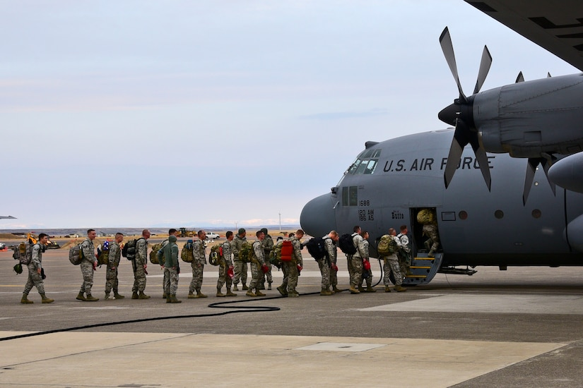 Members of the 219th RED HORSE Squadron of the Montana Air National Guard board a 120th Airlift Wing C-130 Hercules transport aircraft in Great Falls, Mont., Oct. 11, 2017. The heavy construction specialists deployed to the United States territory of Puerto Rico to assist with Hurricane Maria relief efforts. (U.S. Air National Guard photo/Senior Master Sgt. Eric Peterson)