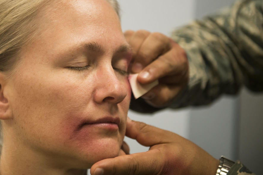 During the project, volunteers wore makeup to emulate domestic violence bruises as they went through their day.