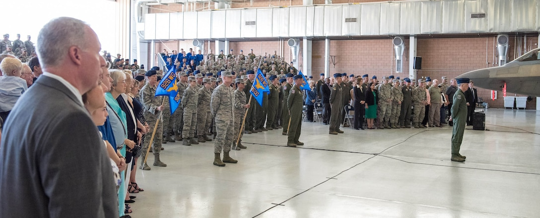 A formation of 926th Wing members prepare to present Col. Michael Schultz with his first salute during a Change of Command ceremony at the Lightning hangar. Schultz took command from Col. Ross Anderson on Oct. 14.