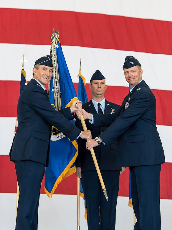 (Right) Col. Michael Schultz, incoming 926th Wing Commander, receives the guidon from Maj. Gen. Ronald Miller, 10th Air Force Commander, during a Change of Command ceremony on Oct. 14 at the Lightning hangar.