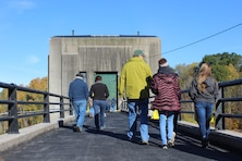Members of the public make their way into Whitney Point Dam's gatehouse during a rare opportunity to see the inside of the gatehouse as part of the celebration of Whitney Point Dam's 75th anniversary Saturday October 21, 2017. The dam in Whitney Point, N.Y., is operated by the U.S. Army Corps of Engineers, Baltimore District and provides flood risk management to downstream communities and its reservoir is a popular recreational spot managed by Broome County Department of Parks and Recreation.