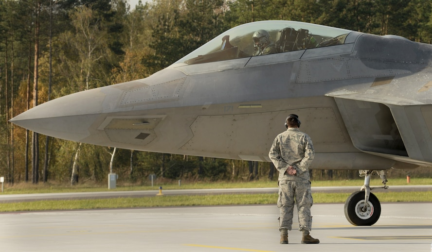 A U.S. Air Force F-22 Raptor pilot from the 1st Fighter Wing, Joint Base Langley-Eustis, Va., prepares for takeoff on the flightline Oct. 17, 2017, at Powidz Air Base, Poland. This forward deployment is an opportunity for the F-22s to maximize training opportunities, demonstrate the U.S. Air Force's steadfast commitment to NATO allies and deter any actions that destabilize regional security. (U.S. Air Force photo by Senior Airman Tenley Long)